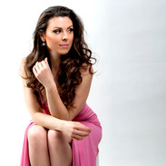 Lisa Toni Burke pensive in pink