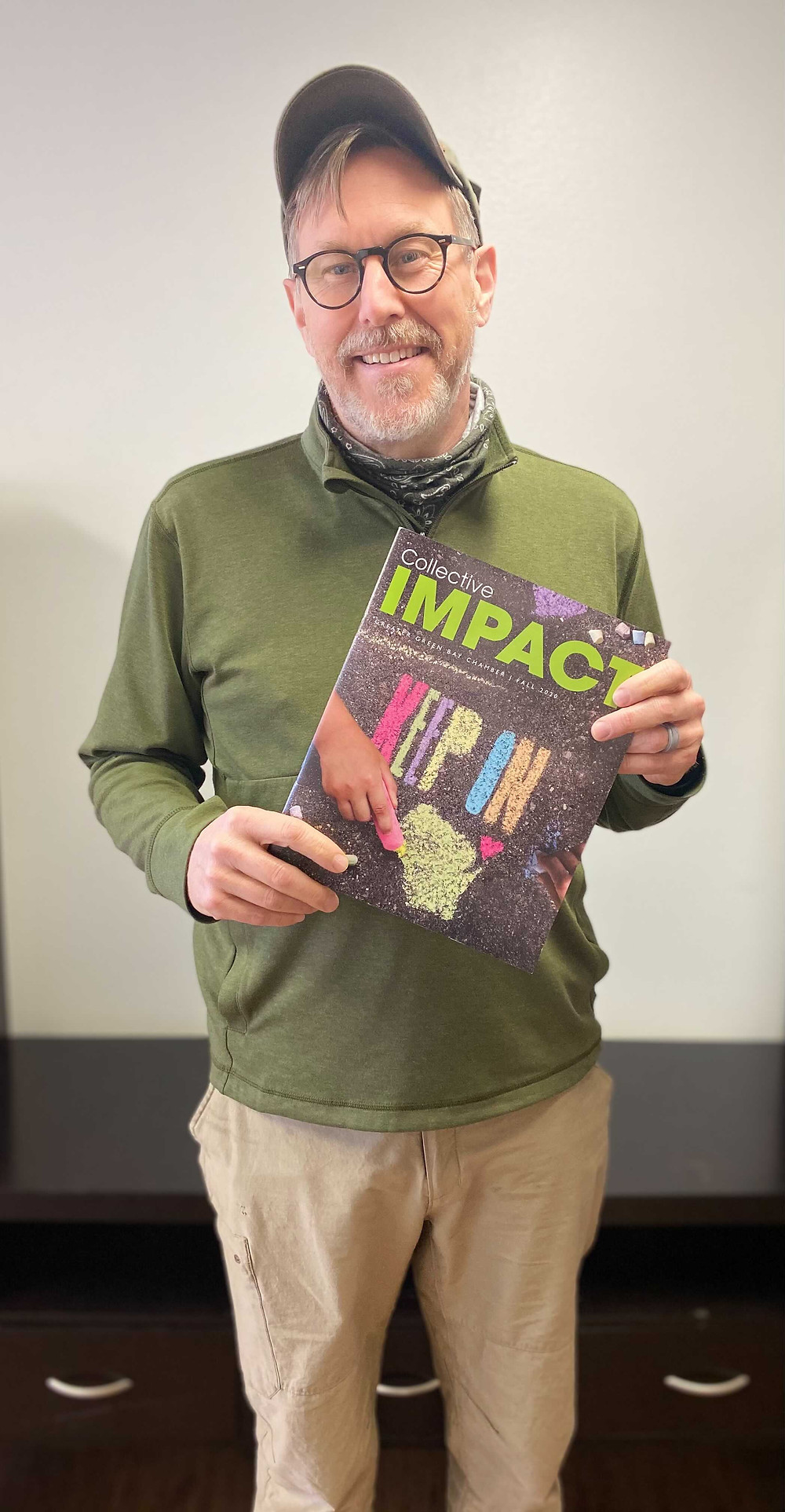 Joseph Beausoleil, President of Gemini Plastics, Inc., holding the latest published Collective Impact 2020.