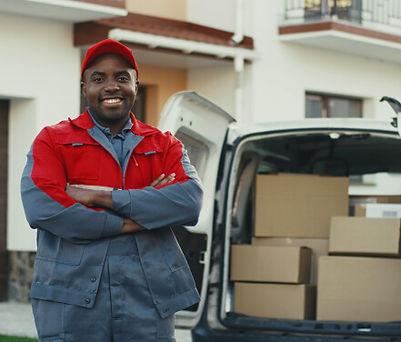 cargo-van-driver-next-to-van.jpg