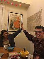 A picture of two of our trustees (Beth and Ross) high-fiving
