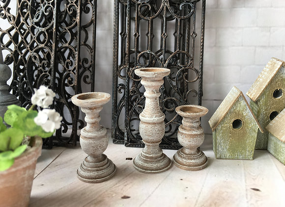 3 Rustic candlesticks