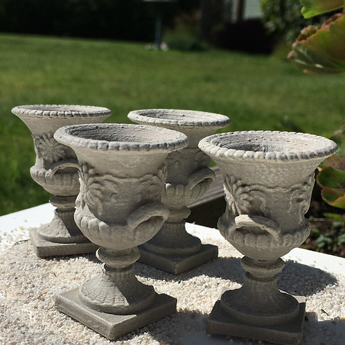 'Concrete' urns with floral emboss
