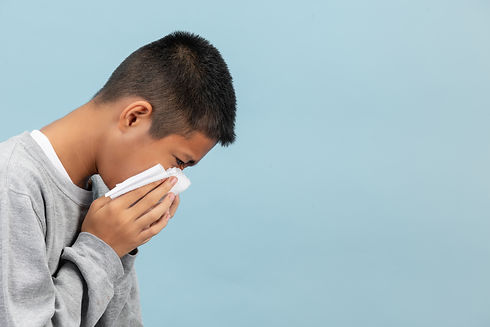 boy-is-sneezing-into-tissue-feeling-sick