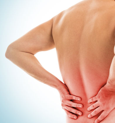 man-holds-his-back-due-pain_edited.jpg