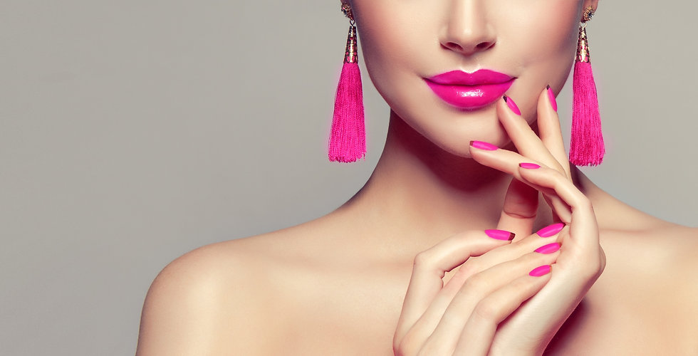 Beautiful model girl with pink fuchsia manicure on nails . Fashion makeup and cosmetics . Large earr