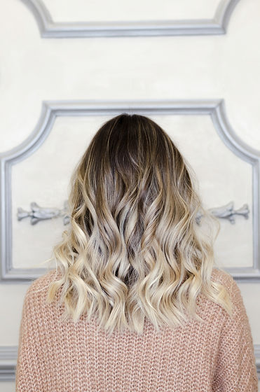 Beautiful woman with balayage hairstyle