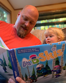Father and son reading A-B-Skis