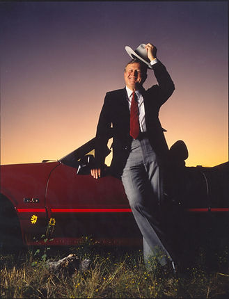 Red McCombs with Ford Mustang and cowboy hat