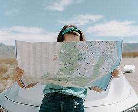 woman-looking-at-the-map-3935702.jpg