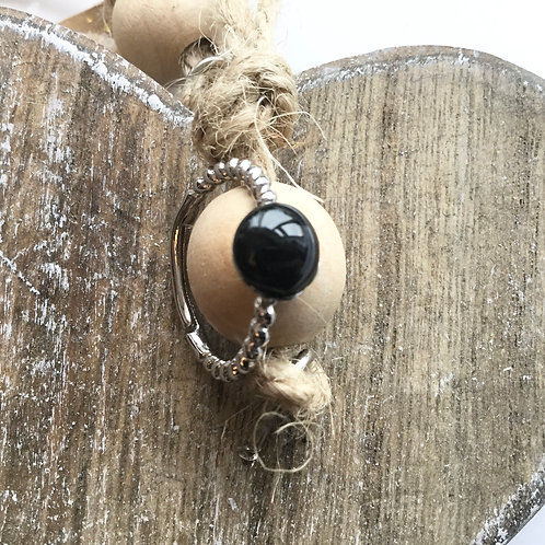 Twisted silver coloured black resin stone ring