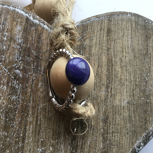 Twisted silver coloured purple resin stone ring