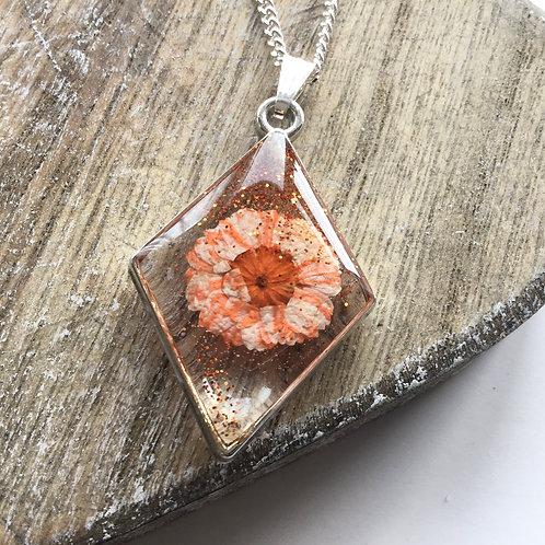 Diamond shaped real daisy pendant
