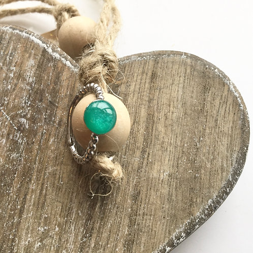 Twisted silver coloured sea green resin stone ring