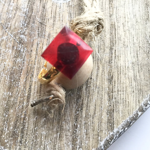 Gold coloured red resin ring