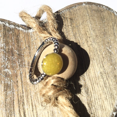 Yellow twisted metal ring