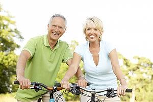 bigstock-Mature-couple-riding-bikes-1390
