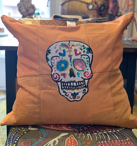 SKULL SEQUIN PILLOW ON ORANGE TARP