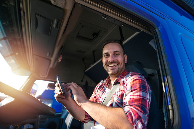 Truck driver with tablet using GPS navig