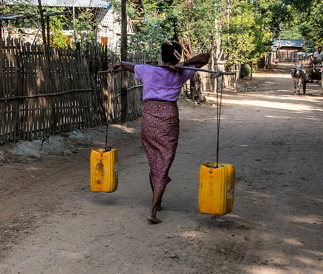 A Woman Carrying Water Home