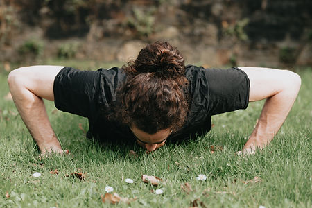 person-does-a-push-ups-outdoors-in-the-g