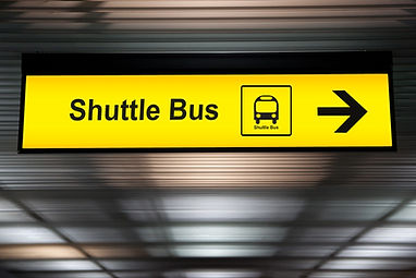 sign with arrow point to shuttle bus sta