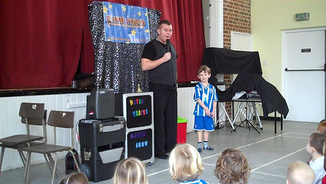 children's magician, birthday party magic show, david tricks, book a magic show,