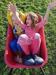 kids in wheel barrow.jpg