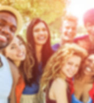 Happy friends taking selfie at bbq picni