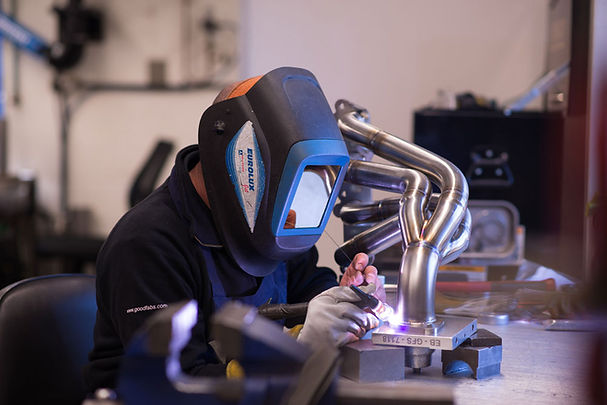 GoodFabs fabricator welding a flange to an exhaust system