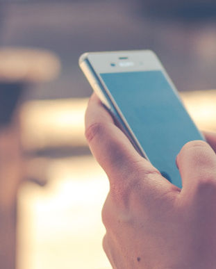 reading-news-on-phone.jpg