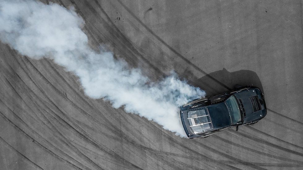 Aerial top view professional driver drifting black car on asphalt road track, Automobile a