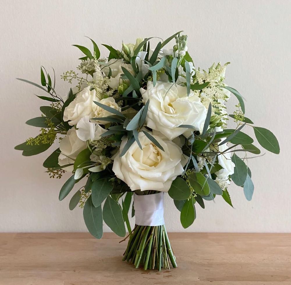 White Garden roses, eucalyptus, Astilbe, Spray roses, Stock, Bridal bouquet