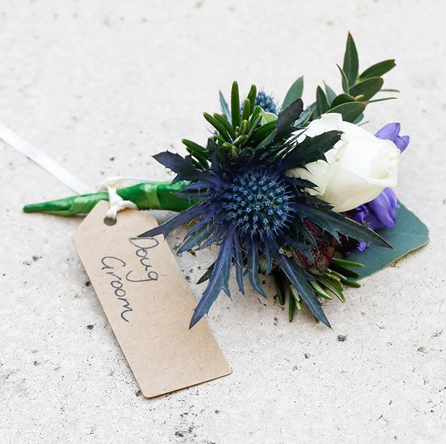 Small clustered wired groom buttonhole