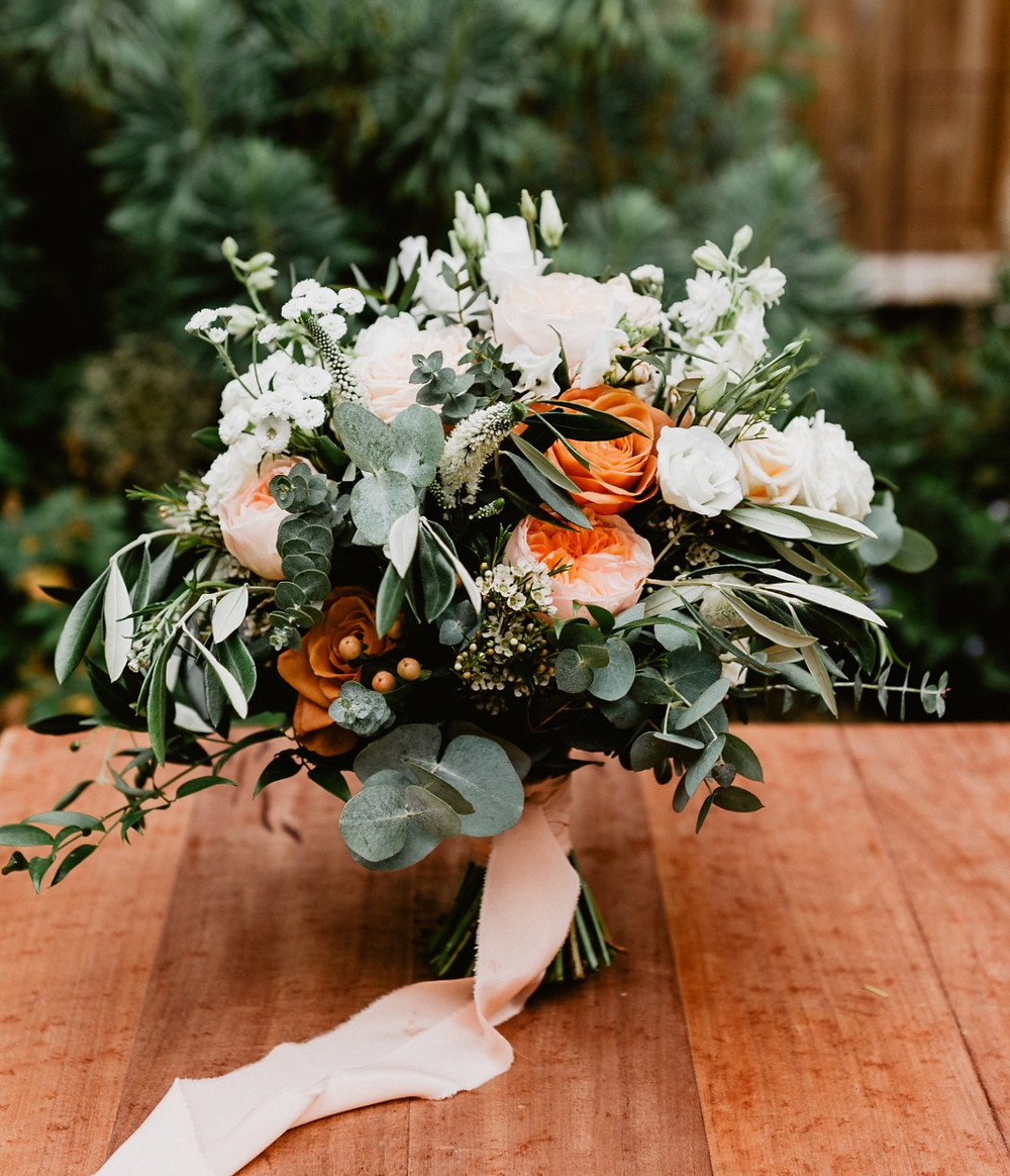 Garden roses, Veronica, Stock, Lisianthus, Sweet Peas Brides bouquet with trailing silk ribbon
