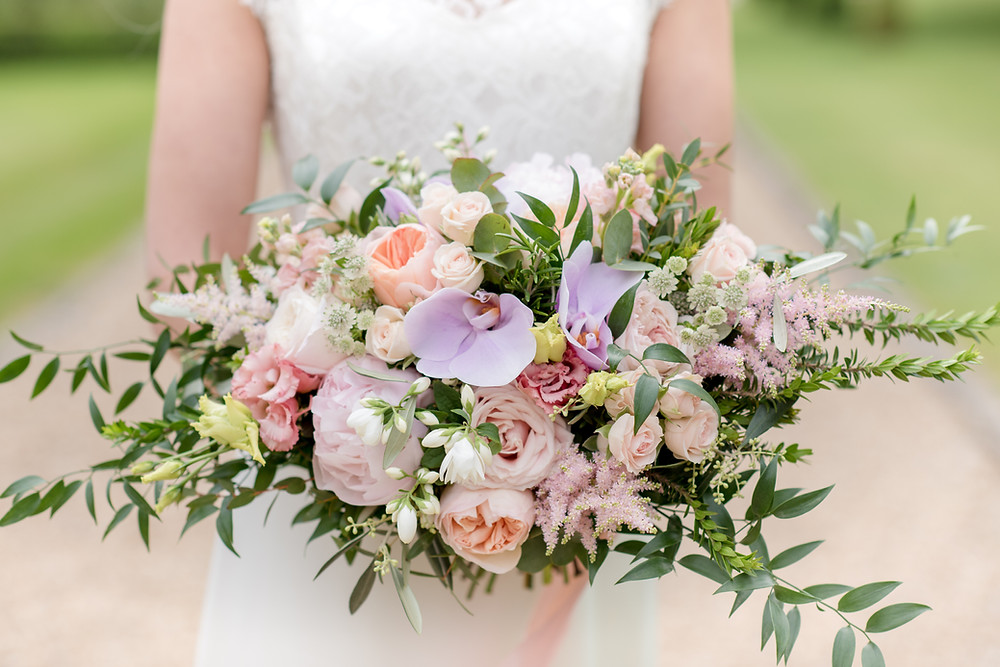 Modern and Elegant Bridal bouquet Roses, Peonies, Garden Roses, Lisianthus, Orange Blossom and Phalaenopsis orchids