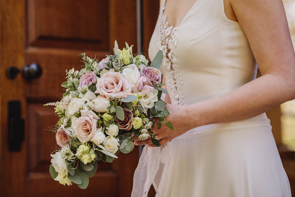 Classic and Romantic wedding bouquet with dusky antique shades of cream and pink and greenery antique Amnesia roses, Peony, Quicksand roses, Nigella and Astilbe.