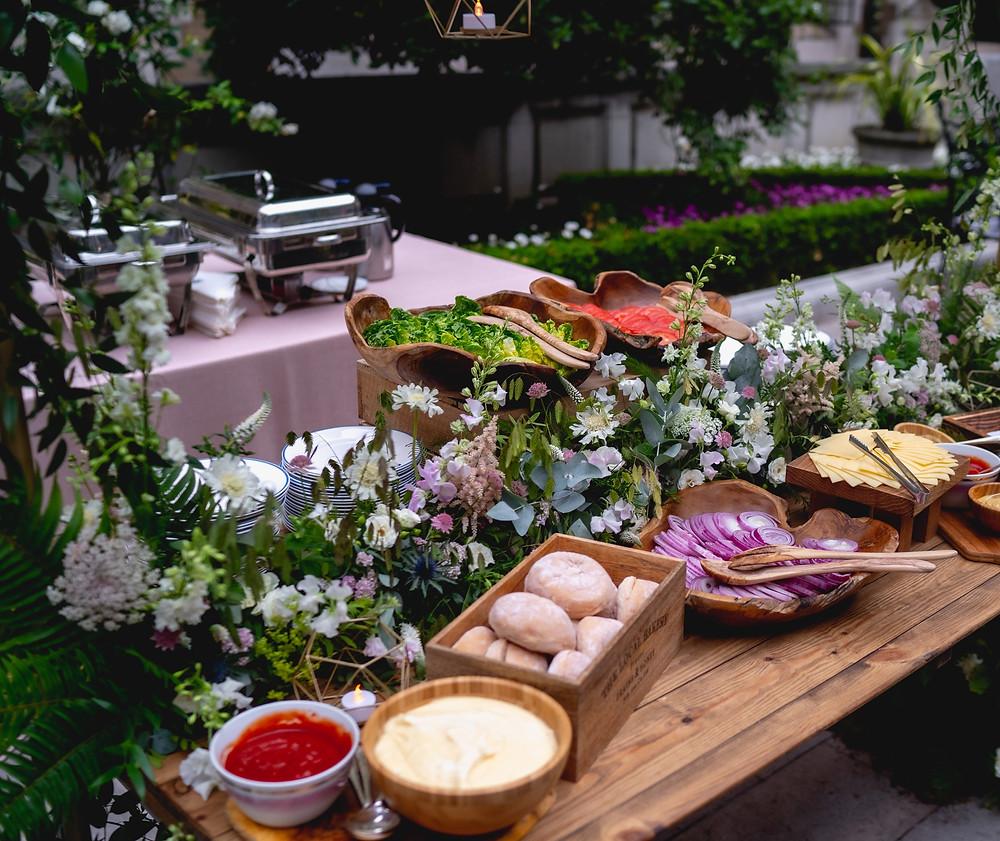 Wedding party flowers  Merchant Taylors Courtyard