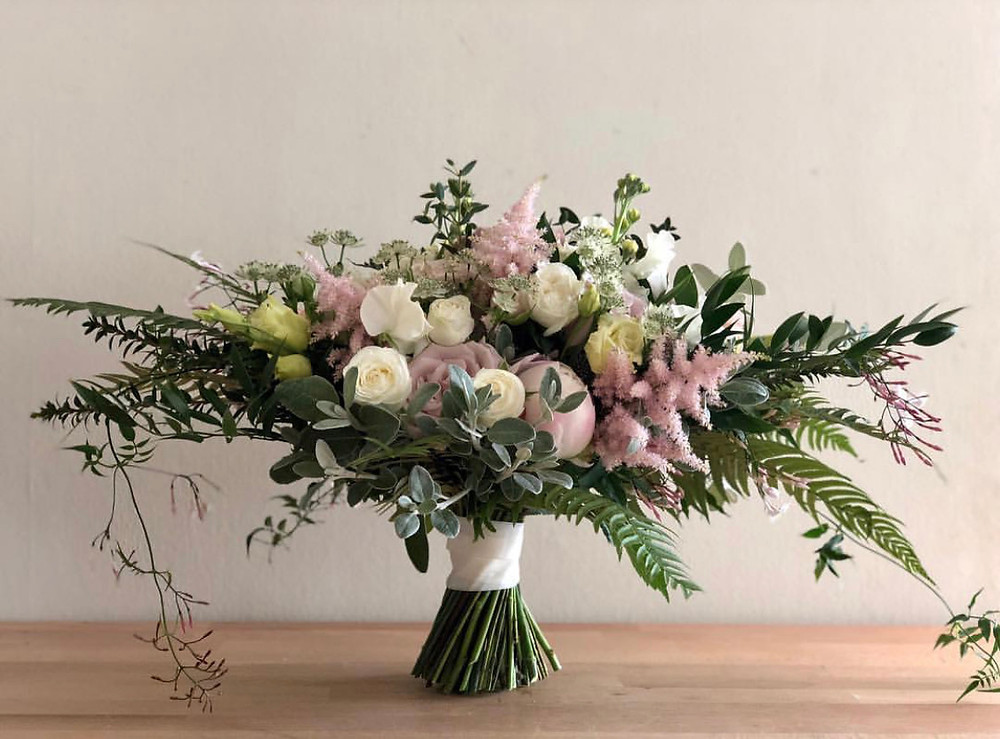 Bridal bouquet of blush pink, cream and white with soft pink Peony