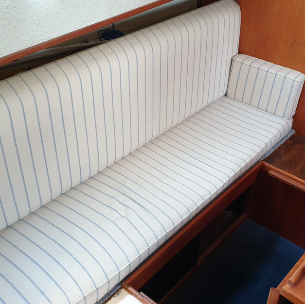 The new holding tank goes under the couch in the saloon