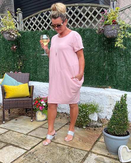 Casual dress with asymmetric panel and side pockets