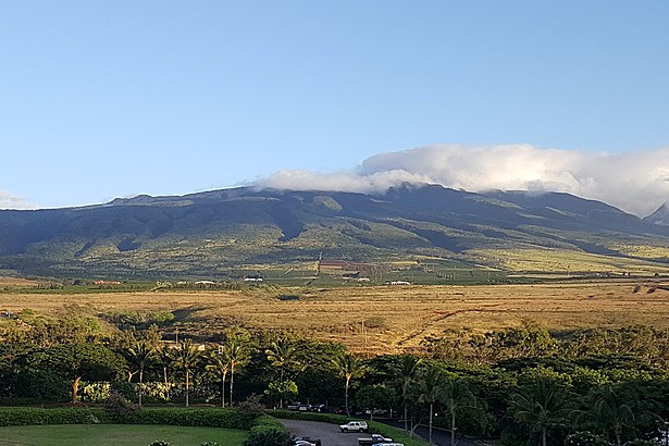 View from the Honua Kai Resort looking east towards the now ancient West Maui Shield Volcano. The incised valleys are caused by post volcanic erosion. The clouds are just clouds and not volcanic activity, although one could imagine!