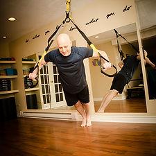 Man doing Pilates on TRX