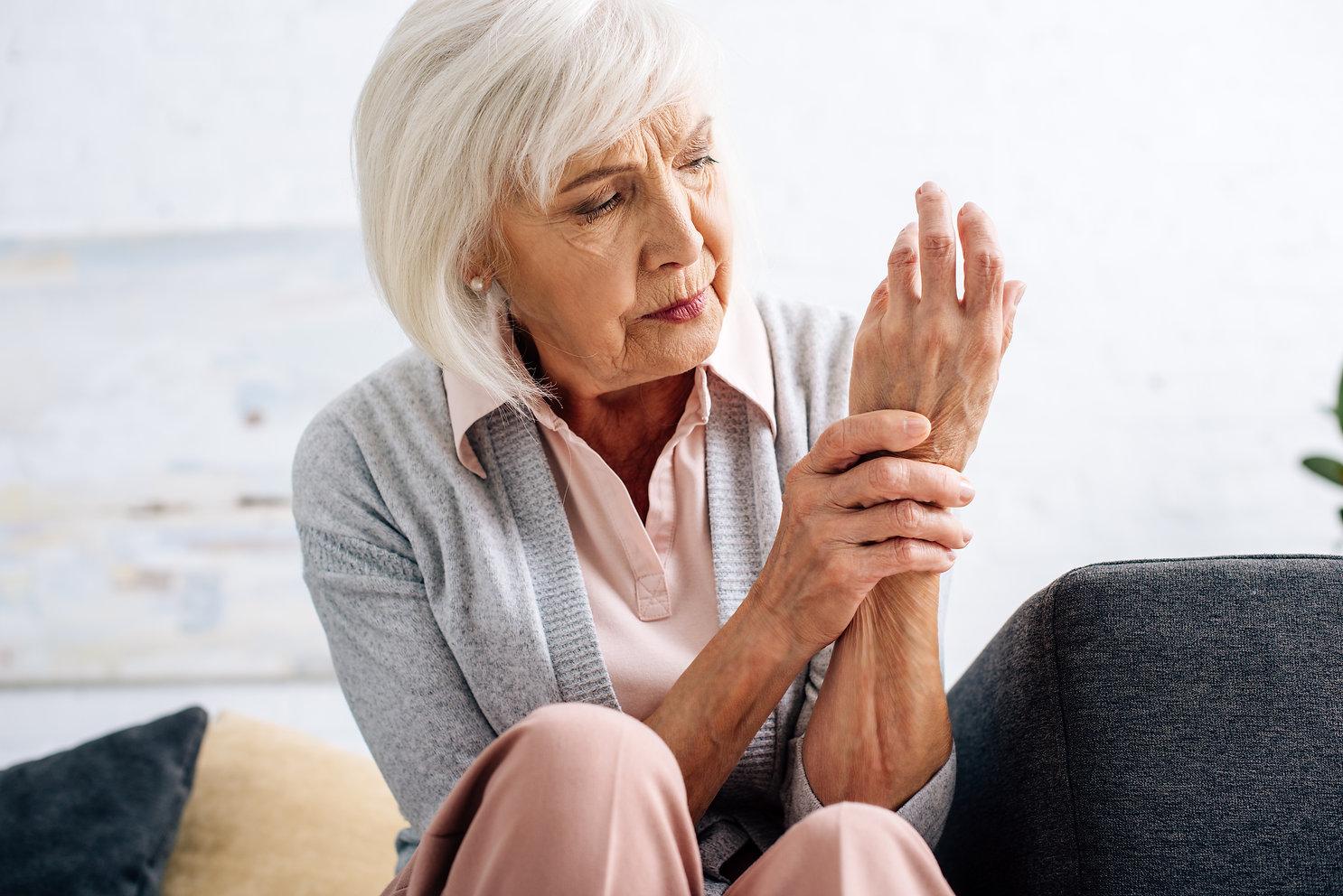 senior-woman-having-hand-arthritis-and-s