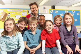 schoolchildren-in-classroom-with-teacher