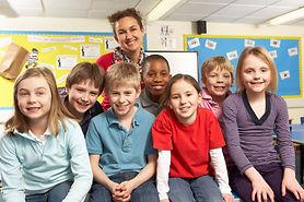 schoolchildren-in-classroom-with-teacher
