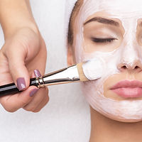 woman-receiving-facial-mask-at-beauty-salon