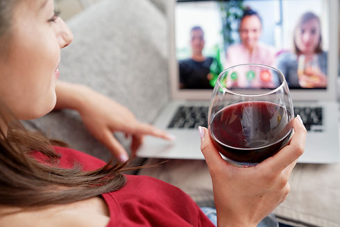 woman-drinking-wine-during-video-confere