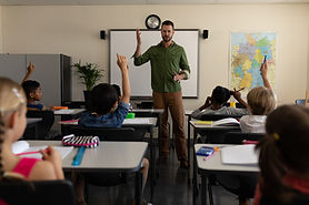 school-teacher-teaching-to-students-in-a