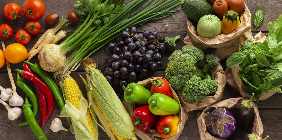 flat-lay-of-organic-fruits-and-vegetables-on-woode-6YDUQQC.jpg
