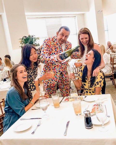 Theirry the wine magician surrounded by laughing ladies